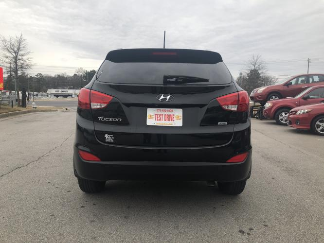 2014 Hyundai Tucson GLS AWD (KM8JUCAGXEU) with an 2.4L L4 DOHC 16V engine, 6-Speed Automatic transmission, located at 4247 Buford Drive NE, Buford, GA, 30518, (678) 450-1000, 34.086857, -83.993004 - Photo #5