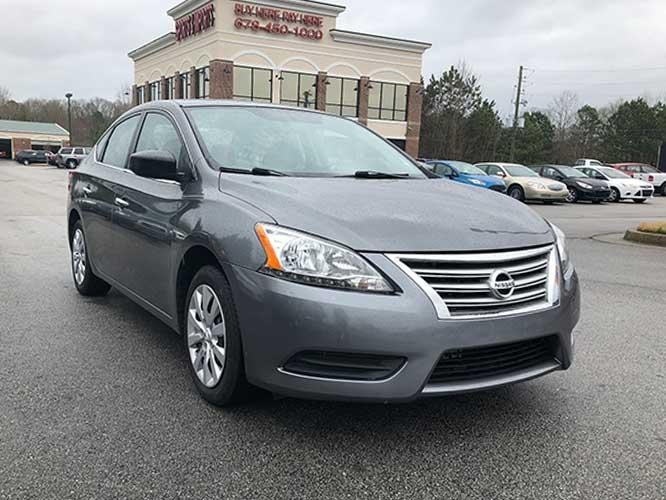 2015 Nissan Sentra S 6MT (3N1AB7AP9FY) with an 1.8L L4 SFI DOHC 16V engine, 6-Speed Manual transmission, located at 4247 Buford Drive NE, Buford, GA, 30518, (678) 450-1000, 34.086857, -83.993004 - Photo #0