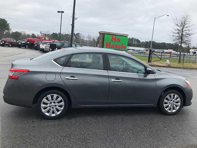 2015 Nissan Sentra S 6MT (3N1AB7AP9FY) with an 1.8L L4 SFI DOHC 16V engine, 6-Speed Manual transmission, located at 4247 Buford Drive NE, Buford, GA, 30518, (678) 450-1000, 34.086857, -83.993004 - Photo #4