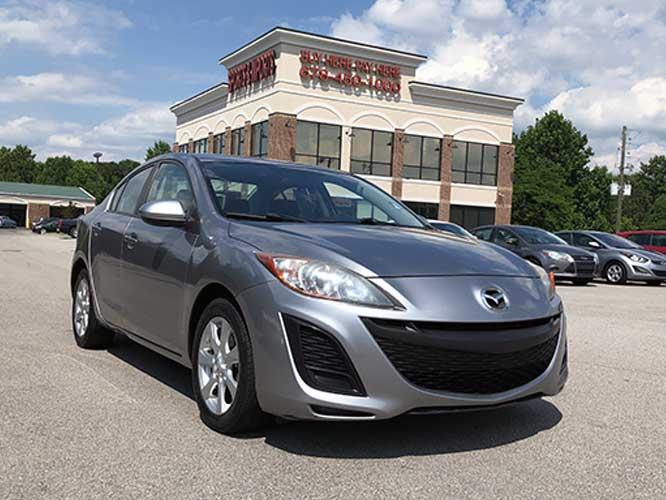 2011 Mazda MAZDA3 i Touring 4-Door (JM1BL1VF3B1) with an 2.0L L4 DOHC 16V engine, located at 4247 Buford Drive NE, Buford, GA, 30518, (678) 450-1000, 34.086857, -83.993004 - Photo #0
