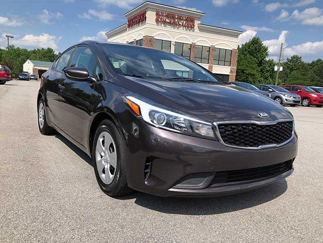 2017 Kia Forte LX 6A (3KPFL4A76HE) with an 2.0L L4 DOHC 16V engine, 6A transmission, located at 4247 Buford Drive NE, Buford, GA, 30518, (678) 450-1000, 34.086857, -83.993004 - Photo #0
