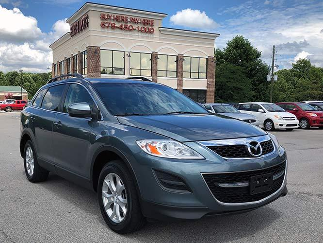 2011 Mazda CX-9 Touring AWD (JM3TB3CV1B0) with an 3.7L V6 DOHC 24V engine, 6-Speed Automatic transmission, located at 4247 Buford Drive NE, Buford, GA, 30518, (678) 450-1000, 34.086857, -83.993004 - Photo #0