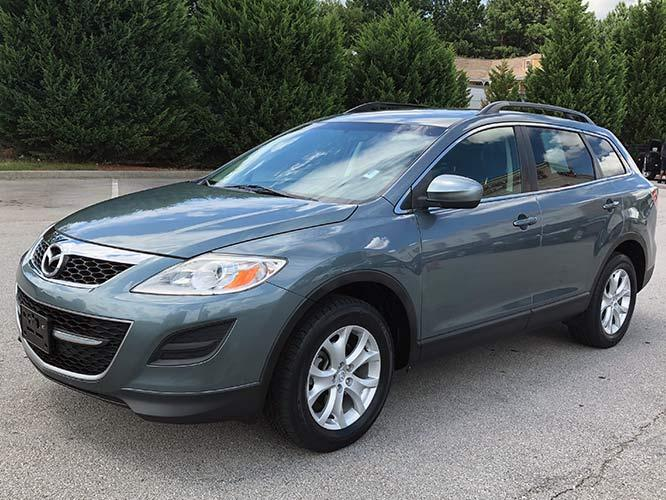 2011 Mazda CX-9 Touring AWD (JM3TB3CV1B0) with an 3.7L V6 DOHC 24V engine, 6-Speed Automatic transmission, located at 4247 Buford Drive NE, Buford, GA, 30518, (678) 450-1000, 34.086857, -83.993004 - Photo #2