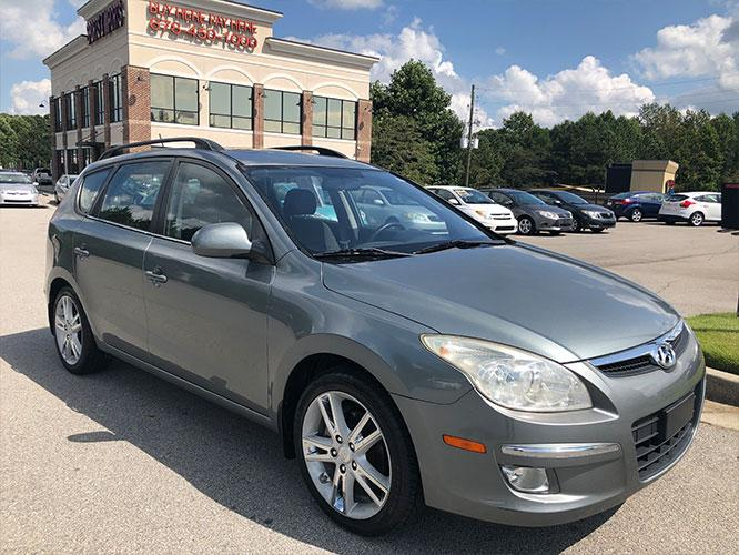 2010 Hyundai Elantra Touring GLS Automatic (KMHDC8AE0AU) with an 2.0L L4 DOHC 16V engine, 4-Speed Automatic transmission, located at 4247 Buford Drive NE, Buford, GA, 30518, (678) 450-1000, 34.086857, -83.993004 - Photo #0