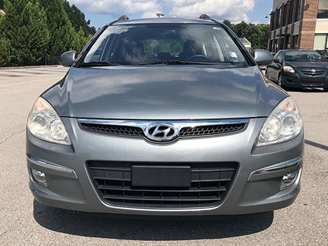 2010 Hyundai Elantra Touring GLS Automatic (KMHDC8AE0AU) with an 2.0L L4 DOHC 16V engine, 4-Speed Automatic transmission, located at 4247 Buford Drive NE, Buford, GA, 30518, (678) 450-1000, 34.086857, -83.993004 - Photo #1