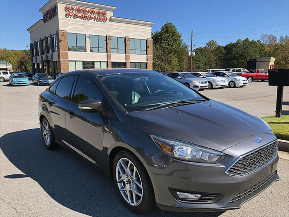 2015 Ford Focus SE Sedan (1FADP3F24FL) with an 2.0L L4 DOHC 16V engine, located at 4247 Buford Drive NE, Buford, GA, 30518, (678) 450-1000, 34.086857, -83.993004 - Photo #0